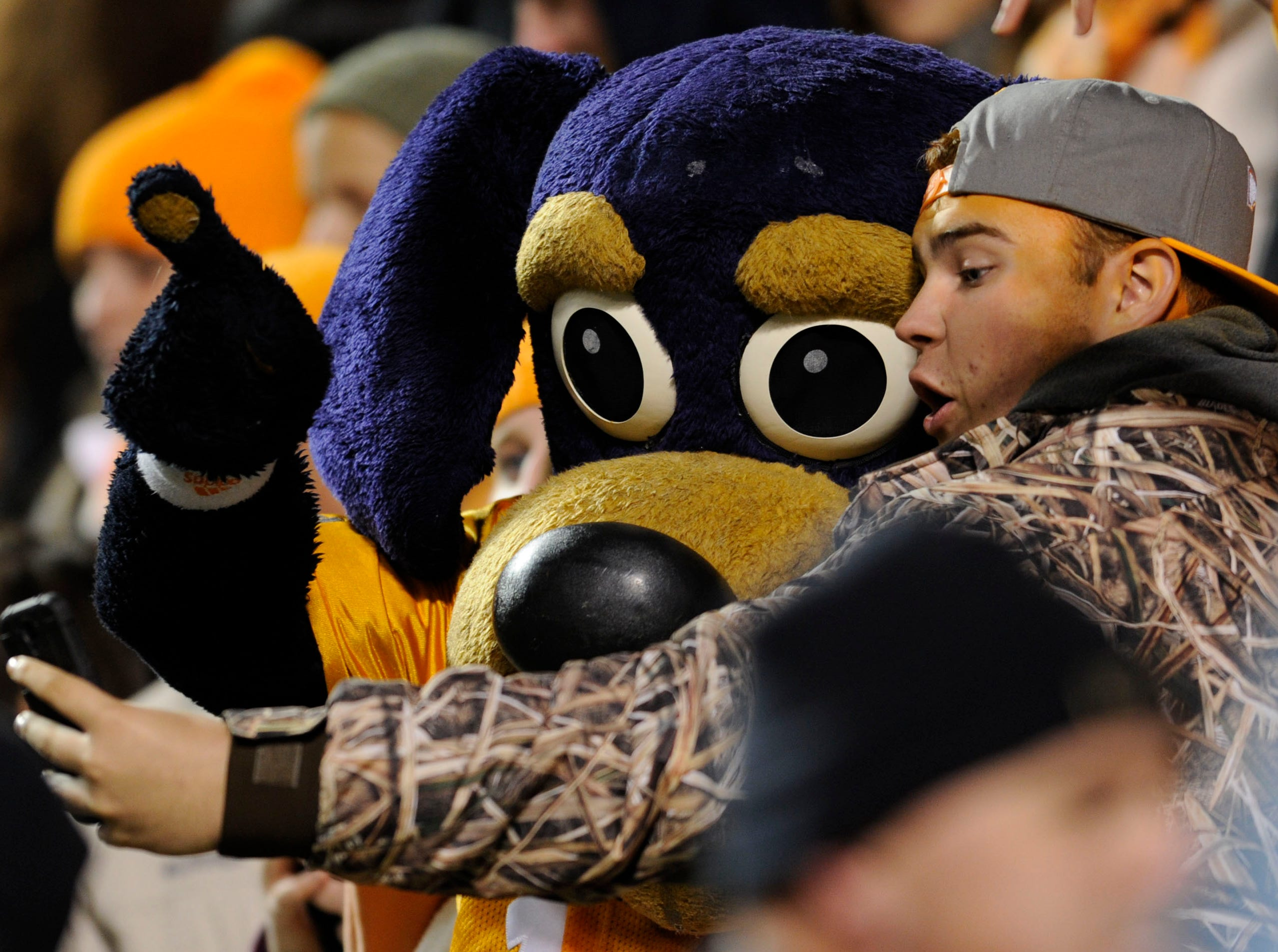 A Tennessee fan poses with Smokey Jr. mascot during the college football game against Kentucky at Neyland Stadium Saturday, Nov. 15, 2014 in Knoxville, TN. UT won the game 50-16, bringing their record to 5-5.