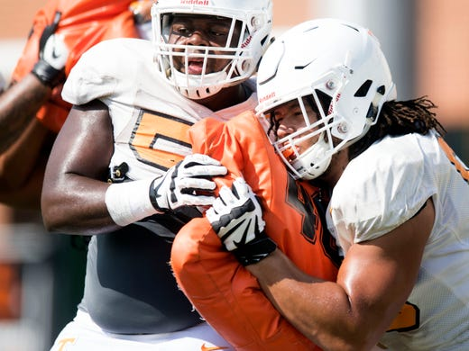 9690a01e7 Tennessee offensive linemen Brandon Kennedy (55) and and Marcus Tatum (68)  during