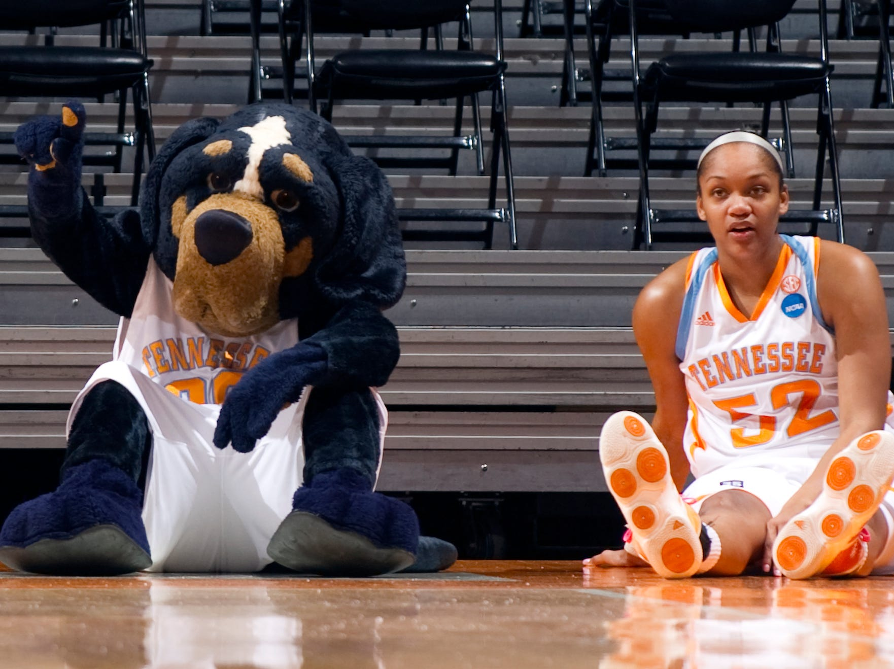 Kelley Cain sits down with Smokey during the game against Stetson. 