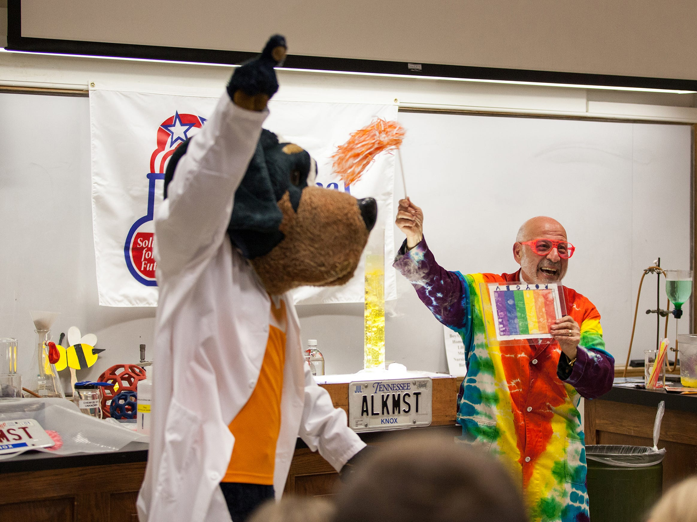 "Dr. Al Hazari, University of Tennessee chemistry lecturer and director of undergraduate laboratories, and Smokey performed chemistry demonstrations at UT during National Chemistry Week. The theme for this year was ""The Sweet Side of Chemistry -- Candy."""