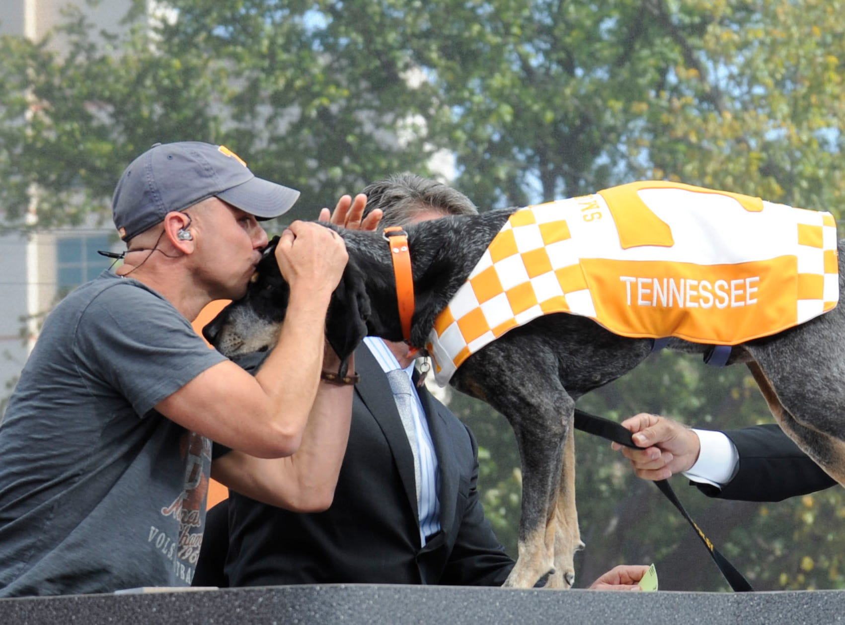 "Kenny Chesney kisses UT football mascot ""Smokey"" during an ESPN College GameDay show on Saturday, Sept. 15, 2012. Chesney appeared as the guest game picker of the week."