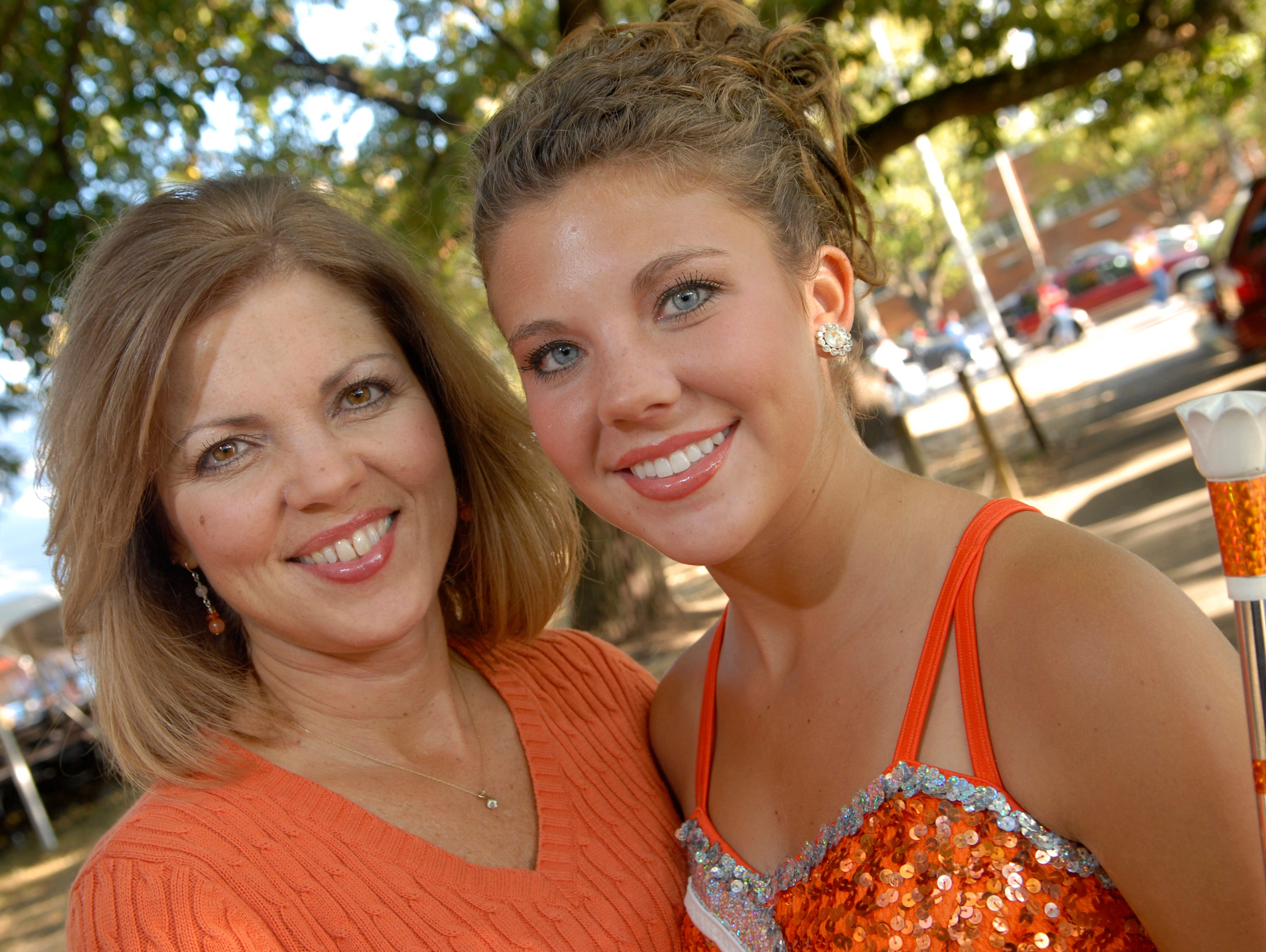 Leigh Ann Summers, a 1984 University of Tennessee graduate and former twirler, left, with her daughter Kristi Summers, a freshman at UT following Friday's UT Homecoming Parade. Both will be performing during Saturday's Homecoming game.