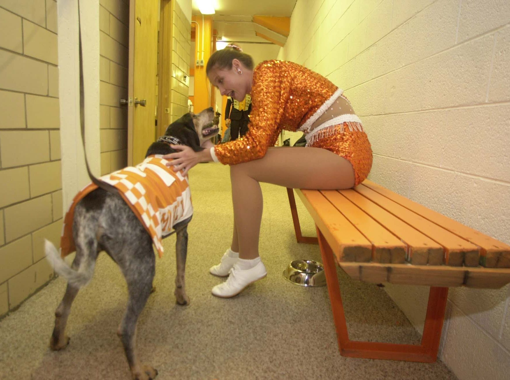 Majorette Karyn Lee says hello to Smokey in the cheerleader's locker room in Neyland Stadium before game time Saturday morning. He goes to the locker room before the game and at half time to get some privacy.