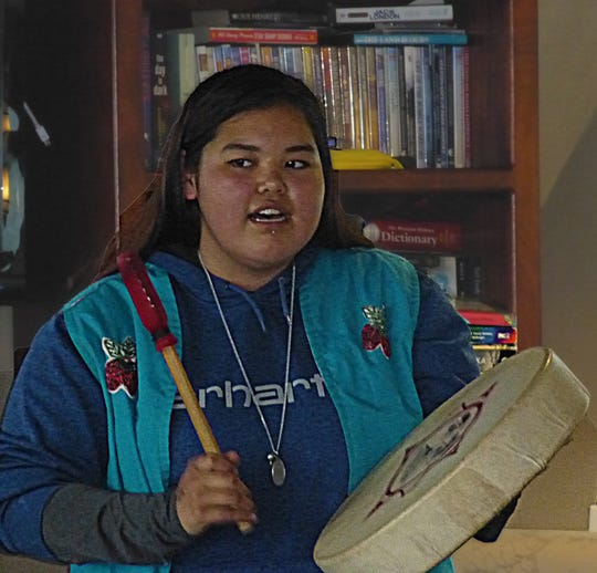 Mary Jack sings traditional Tlingit songs while beating a ceremonial drum she made from dried deerskin. The 18-year-old represents the nonprofit Alaska Native Voices project, working in conjunction with the National Park Service.