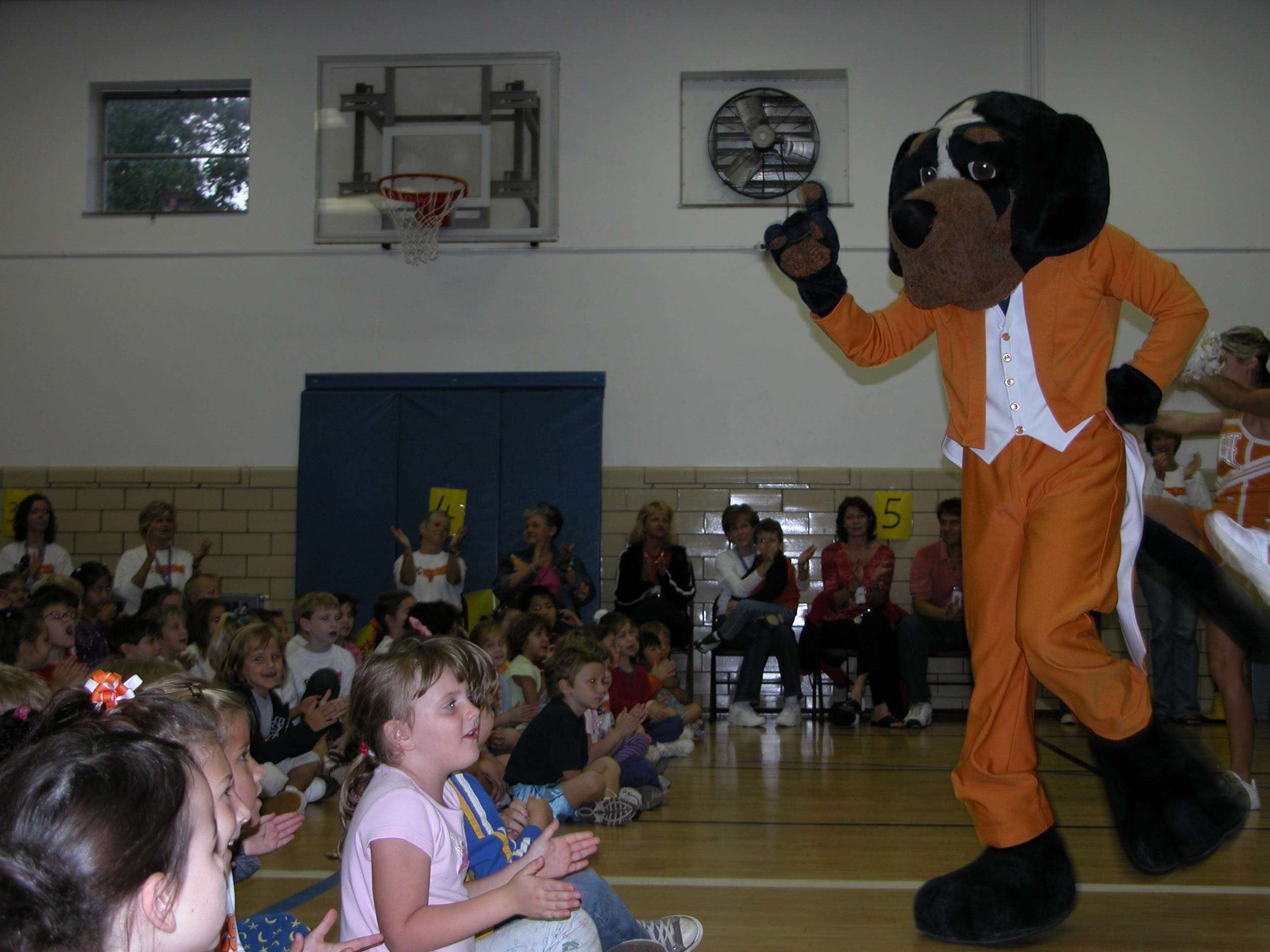 Smokey the Dog dances for Sequoyah Elementary students during their annual coupon book celebration Oct. 12. The school raised over $24,000 in coupon book sales.