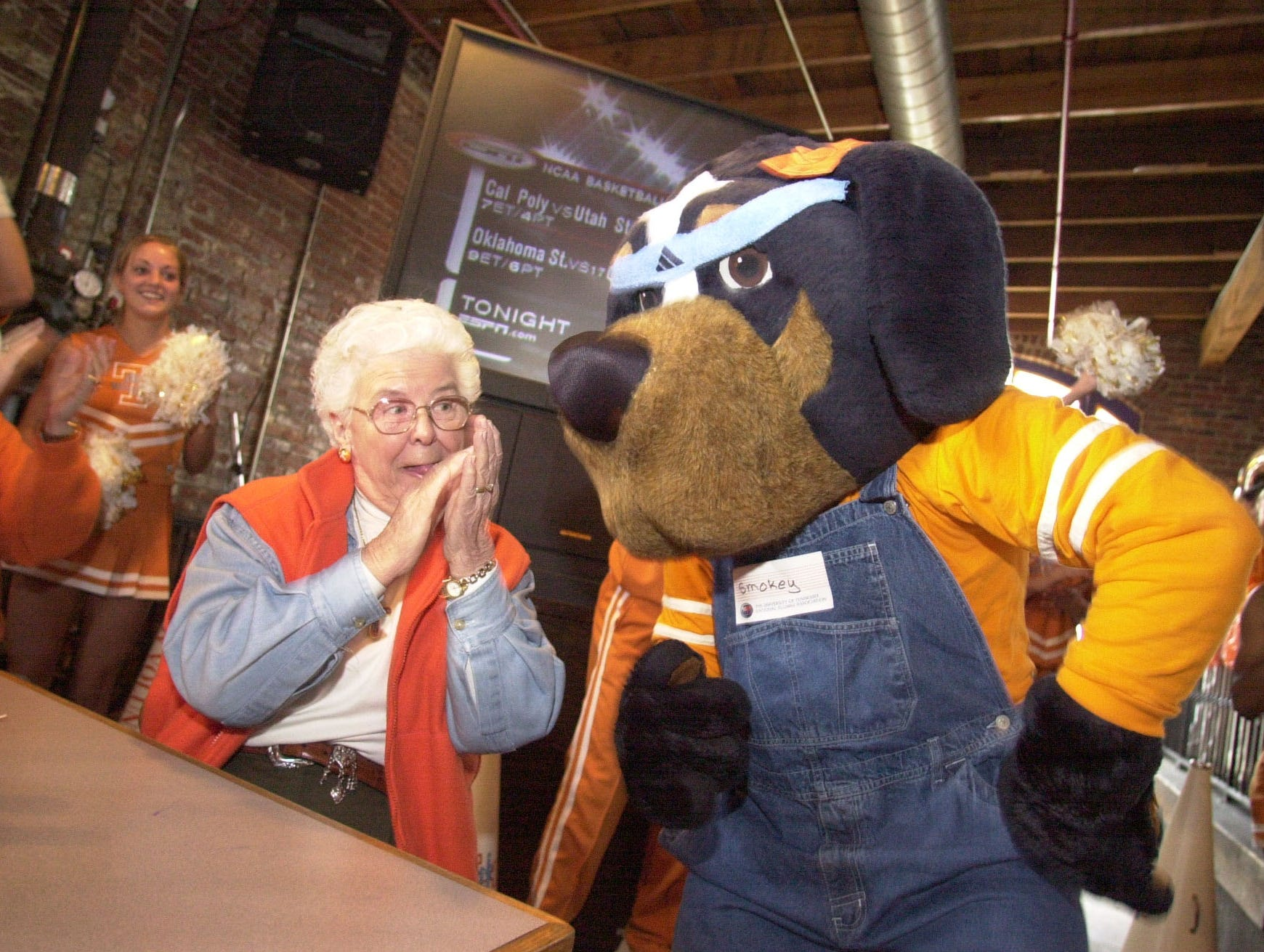 0303fans.2.CC --sports--Longtime Lady Vol fan Franicis Brett of Memphis cheers with the mascot Smokey on Saturday during a pep rally at High Point Pinch Bar and Grill in Memphis.