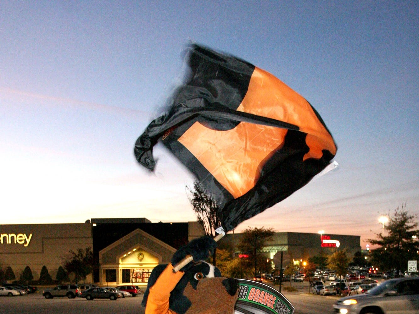 "Smokey waves the ""Power T flag,"" in the air at the red carpet affair at West Town Mall's Santa debut Nov. 15."