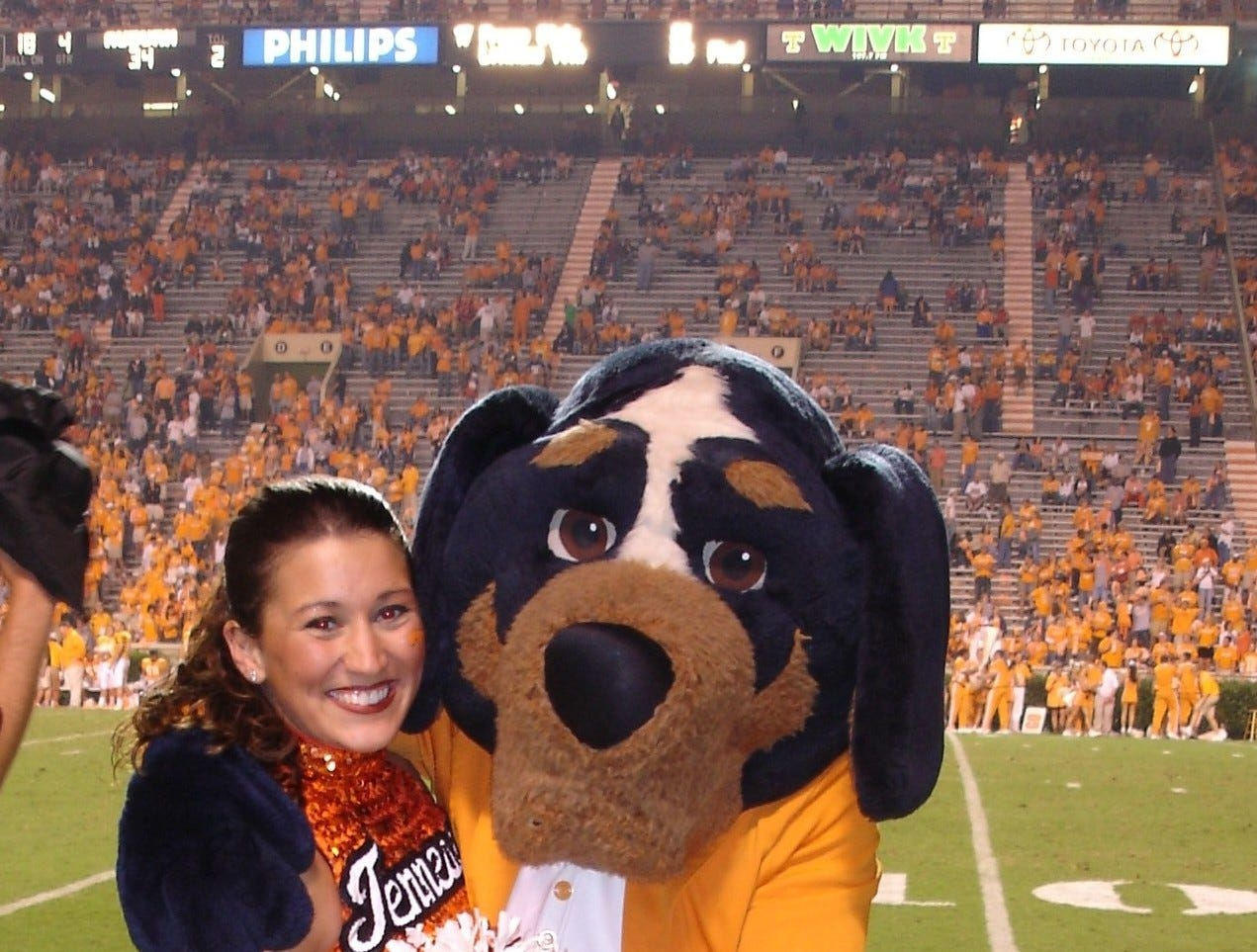 UT Dance Team member Sarah Mikels with Smokey.