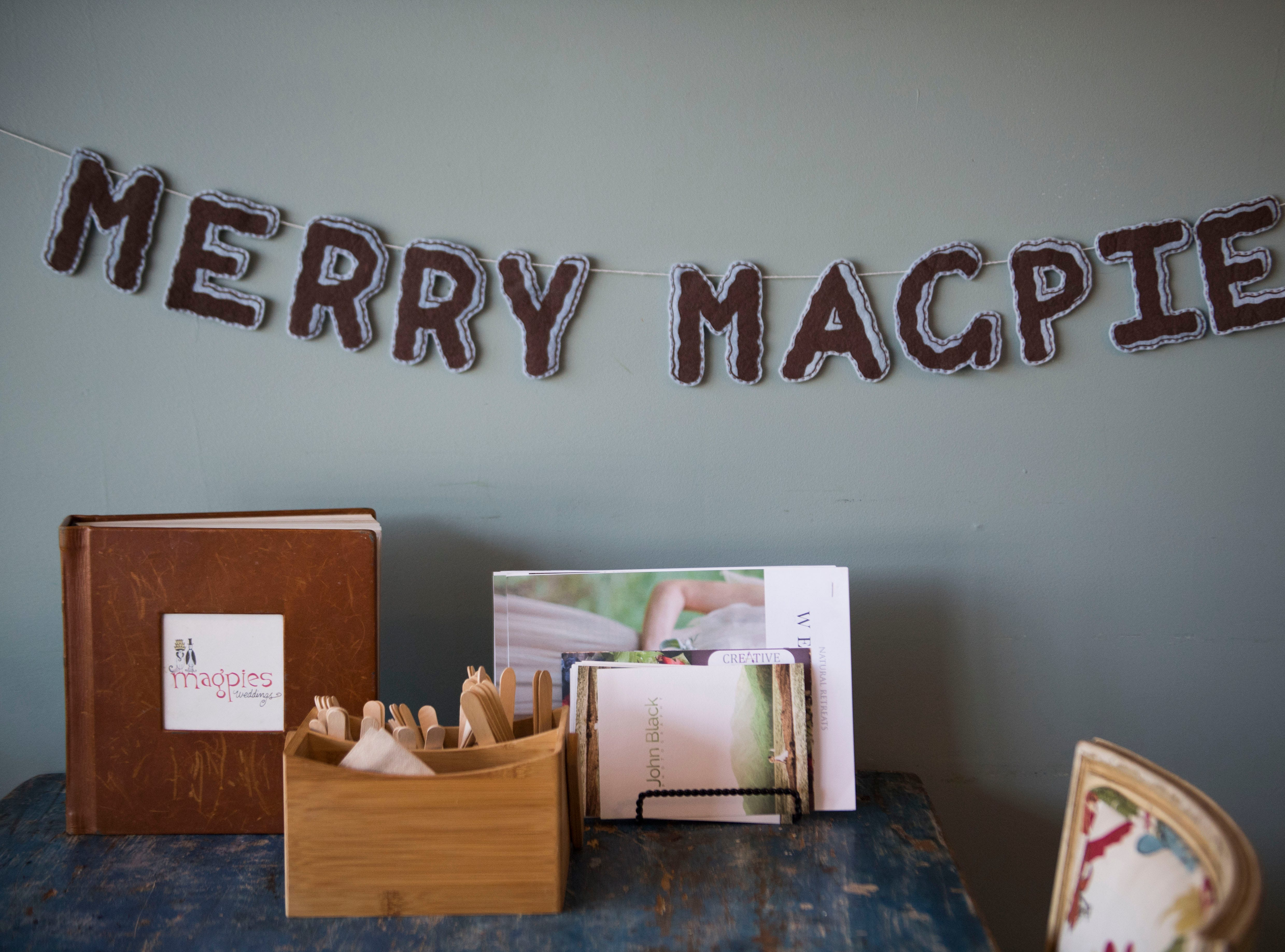Decor hangs in Magpies Bakery, located on North Central Street Tuesday, Aug. 28, 2018. Elizabeth Smith bought the bakery from her aunt, Peg Hambright, in January.