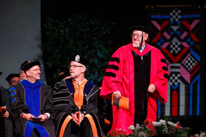 Larry Taylor, right, at the University of Tennessee sprint 2017 commencement ceremony.