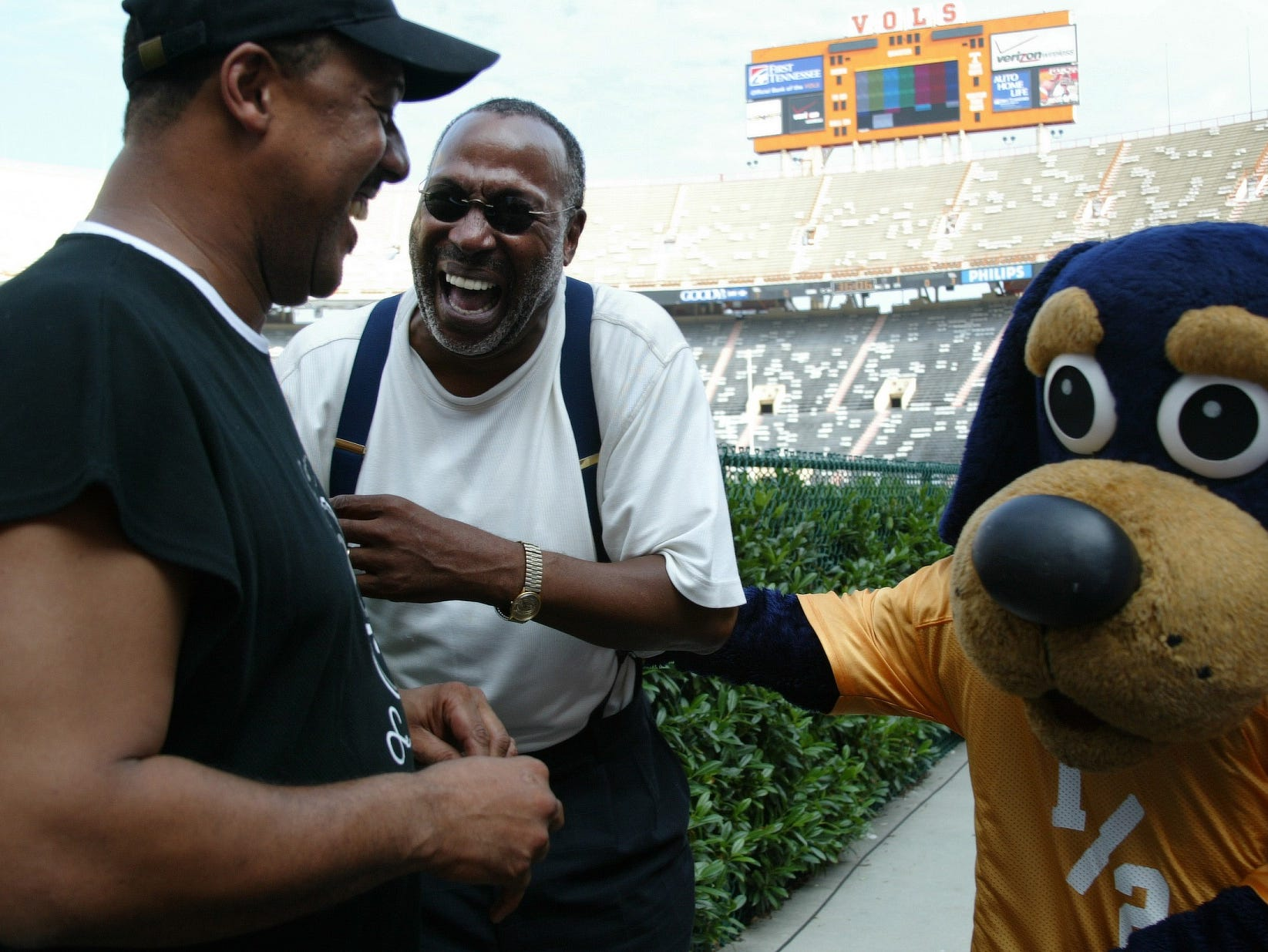 Former Tennessee players Wilbert Jones, left, a defensive back who lettered in 1978-80, and Lester McClain, a wingback who lettered from 1968-70, share a laugh with a UT mascot on Saturday at Neyland Stadium. The two are attending UT's first annual Letterman's Reunion  being held this weekend.