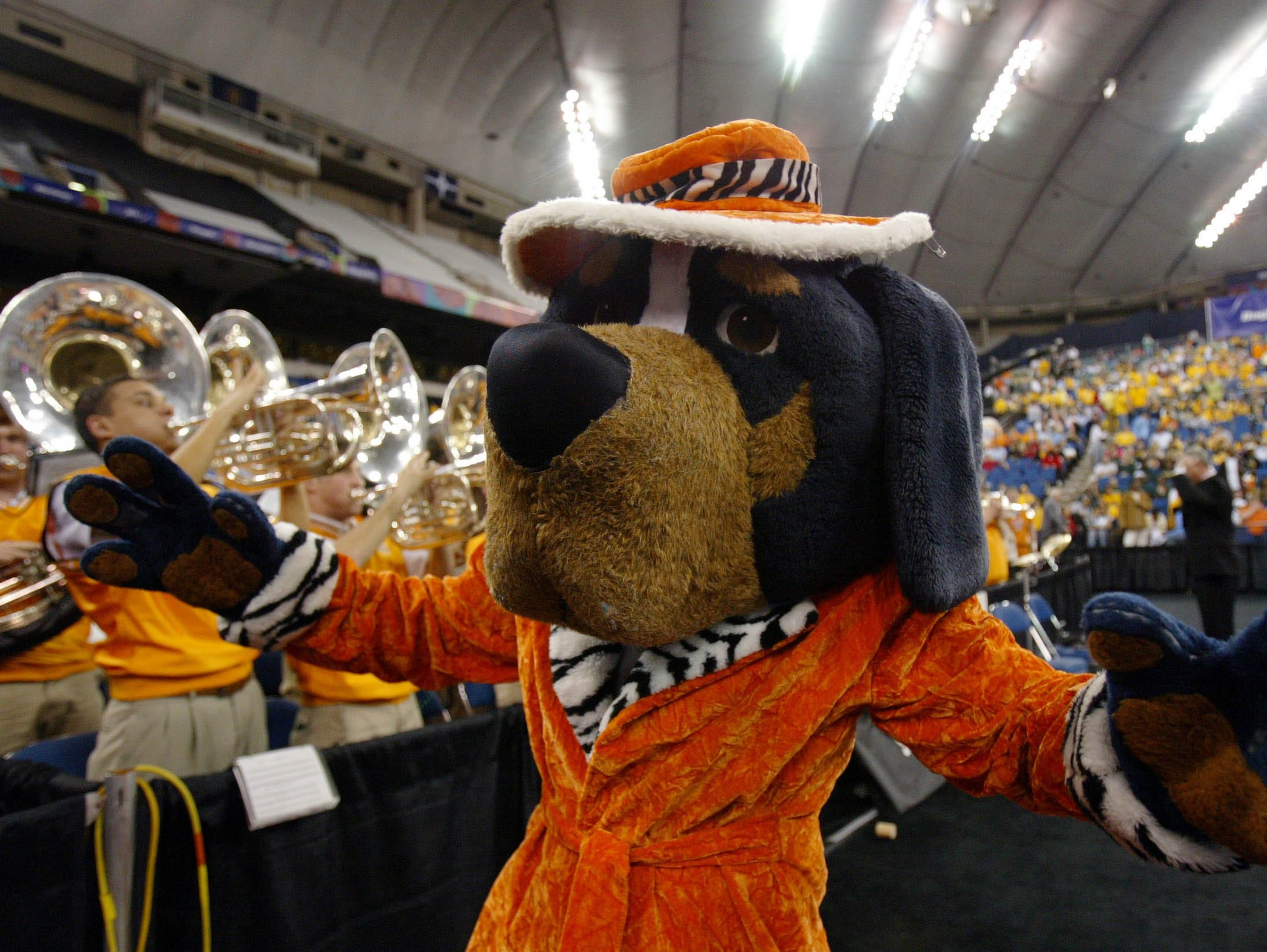 0403ncaa4.cc.jpg---sports---University of Tennessee mascot Smokey and the Pride of the Soouthland Band rev up the fans during the semifinal game of the Women's Final Four in Indianapolis. Michigan State advanced by beating the Lady Vols 68-64. 04/03/05