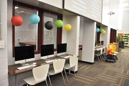 Fulton High media specialist Nichole Dossett uses pops of color throughout the library, creating an energetic learning space for students and teachers.