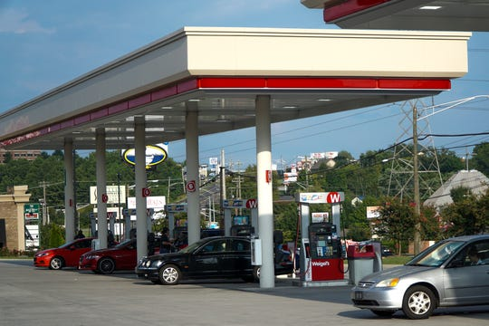 Cars park at the pumps at the Weigel's gas station on Kingston Pike near Bearden Hill on Monday, Aug. 27.