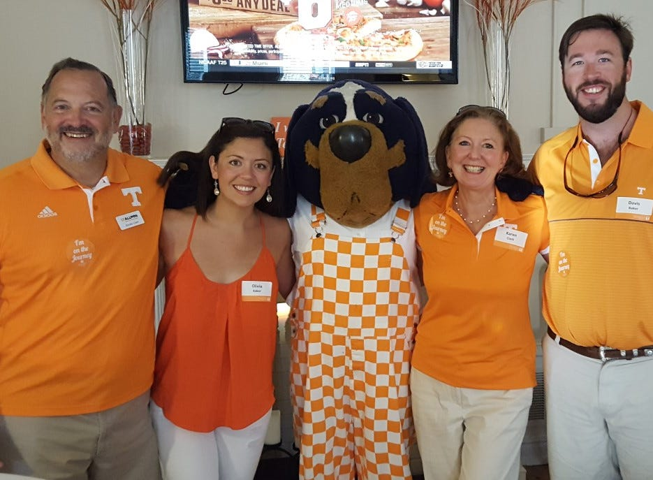 From left are Brooks Clark, Olivia Clark Baker, Smokey, Karen Clark and Davis Baker wearing their orange at the Tyson Alumni House tailgate before the Tennessee vs. Ohio game.