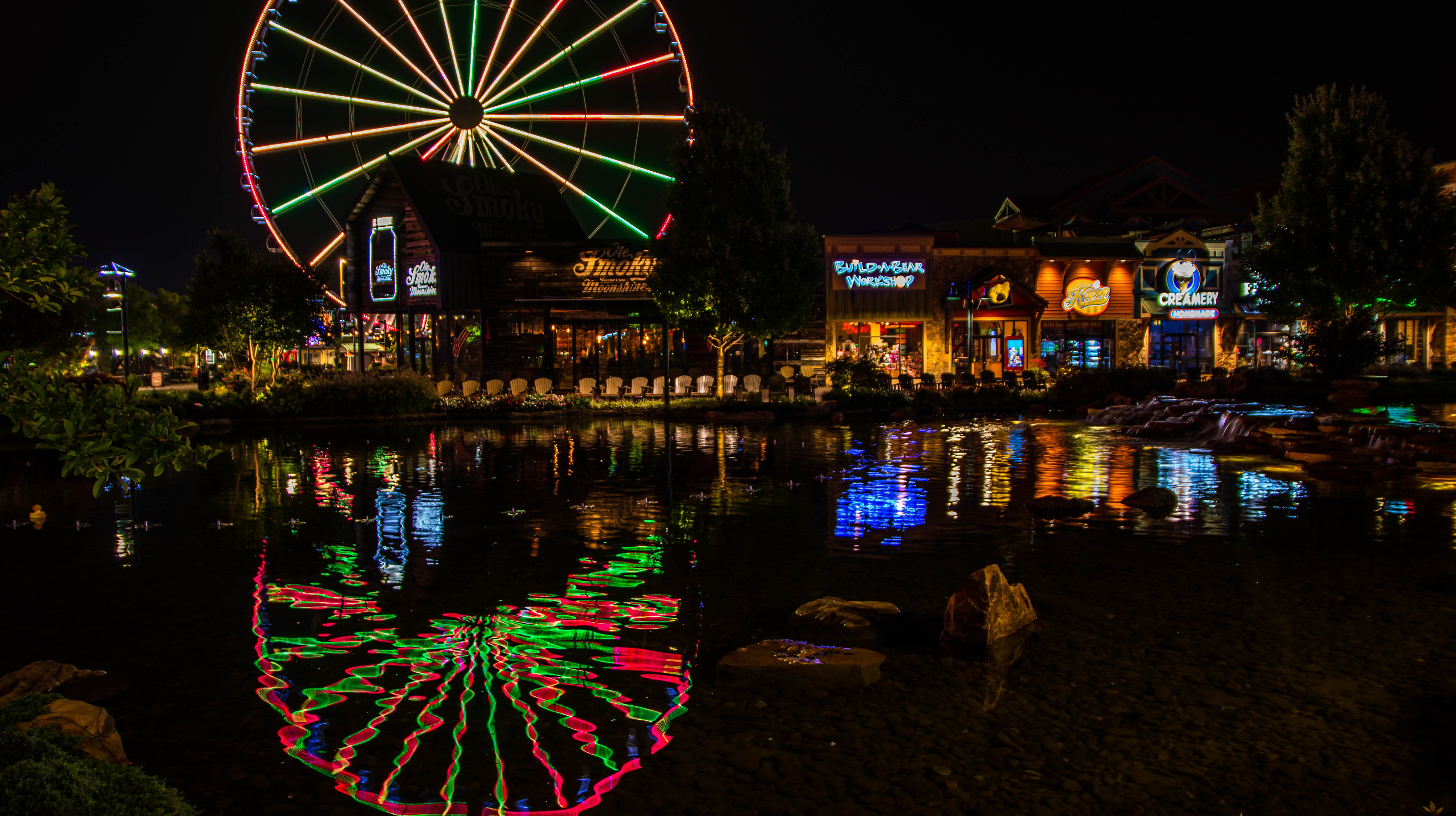 Lights reflect off the water at The Island in Pigeon Forge in Sevier County before sunrise on Monday, Aug. 27, 2018.  Visit Kennedy's website to see more of his photos, https://mikekennedyphotography.smugmug.com.