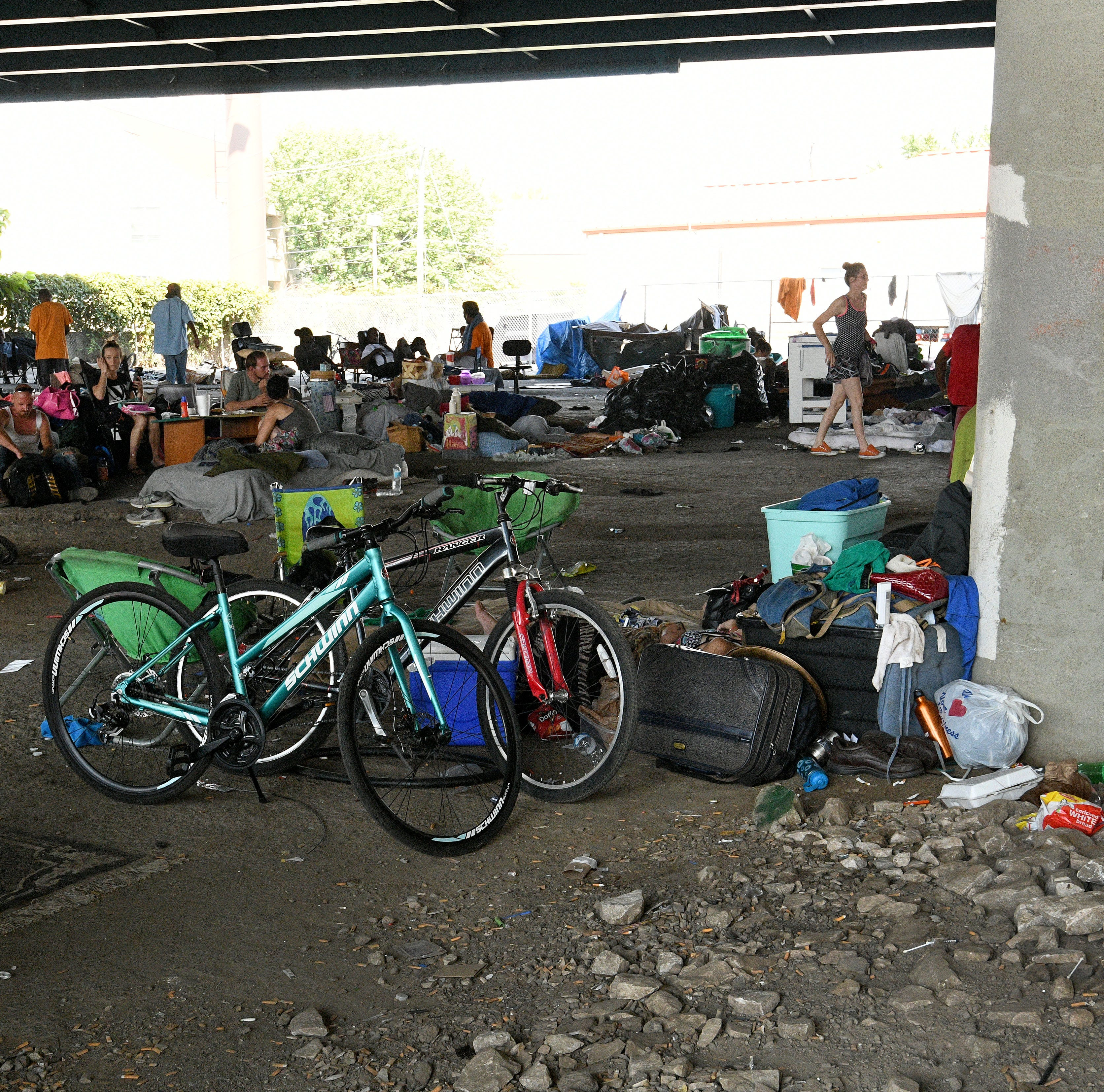 'Under the bridge': City addressing homeless camp by turning space to secured day center — with mixed reactions