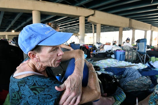 Cecilia Burkholder, 49, is one of many homeless people living under the Broadway viaduct under Interstate 40 Tuesday, August 28, 2018.