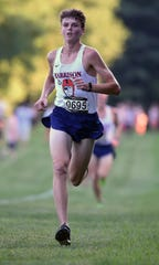 Harrison's Caleb Williams leads the guys into the gate as Harrison hosted the City/County cross country meet Tuesday at the Tippecanoe Amphitheater.
