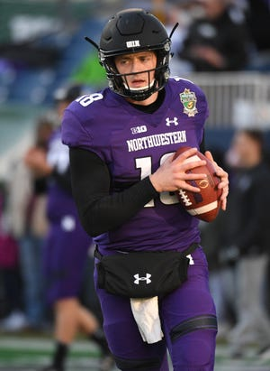 Northwestern Wildcats quarterback Clayton Thorson (18)  might see action Thursday at Purdue in the season opener