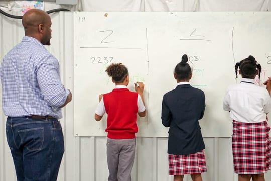 A teacher at T.M. Landry College Prep leads a math lesson in December 2017 at the Breaux Bridge campus.