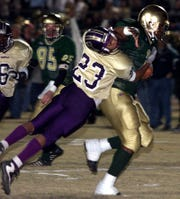 Former Acadiana High running back Alley Broussard, shown here throwing a Hahnville defender off him, was the top vote-getter on the Rams' all-time best players list.