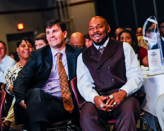 Local football legends Jake Delhomme, left, and Kevin Faulk, right, pictured here at a previous Daily Advertiser Sports Awards Banquet at the Cajundome, discuss the NFC and AFC Championship Games this weekend.
