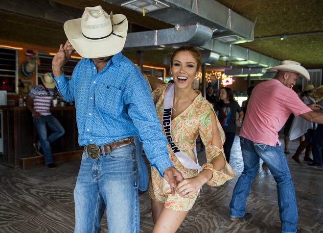 Jason Dupuis dances with Miss Michigan USA Rashontae Wawrzyniak at Whiskey River Landing in Henderson, La., Friday, July 3, 2015. Management announced Tuesday that the dancehall is closing.