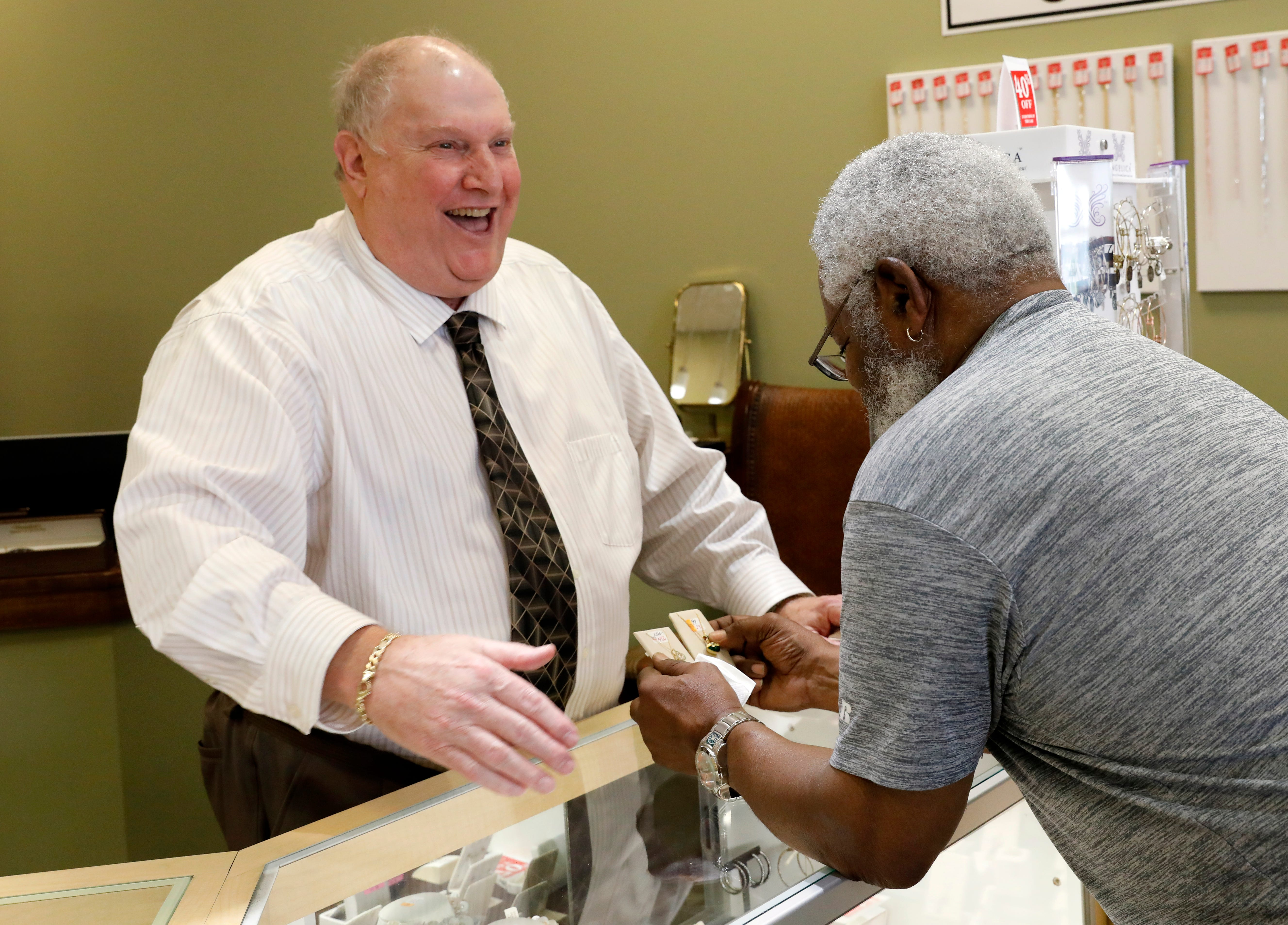 Stuart Palestrant laughs as he helps customer Chuck Williams, from Reynoldsburg, Tuesday afternoon, Aug. 28, 2018, at Wendel's Diamond Jewelers in Lancaster. Palestrant is retiring after 40 years of working at the store and owning it for the last 30 years.