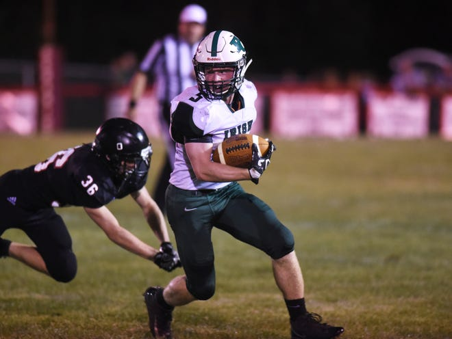 Fisher Catholic's Nick Krooner looks for room to run against Crooksville on Friday night at Village Park. The Irish won a season-opener for the first time in nine years with a 28-7 victory.