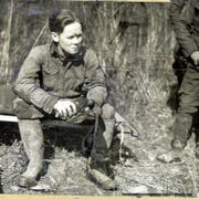 "William Burke ""Skeets"" Miller rests after a trip down in Sand Cave"