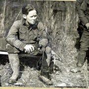 "William Burke ""Skeets"" Miller rests after a trip down in Sand Cave"
