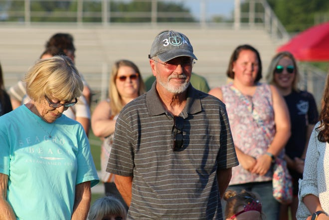 Cy Tucker was honored Monday during a ceremony at South Oldham, where the turf field now is named for the school's former girls soccer coach.