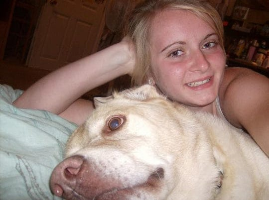 Mikayla Fox, with her childhood dog Chesney, said seeing Aimee Nelson in tears over her ailing dogs made her want to help.