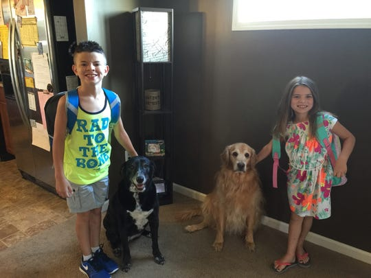 Sadie and Blitzen with Aimee Nelson's two children, Jaxson, 11, and Kenna, 9. The family had to recently have both dogs euthanized.