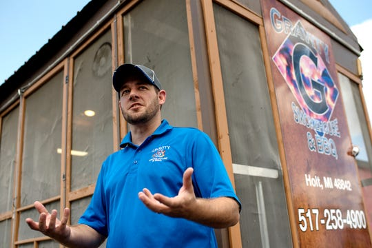 Bruce Kring with Gravity Smokehouse & BBQ food truck, talks about his business outside the Michigrain Distillery Inc. on Thursday, Aug. 23, 2018, in Lansing.