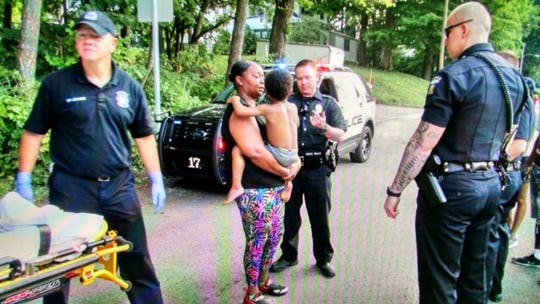 April Jones said she saw the boy fall in North Lake Park Monday night, according to the Mansfield police report. She went in and found him under the water and brought him to safety.