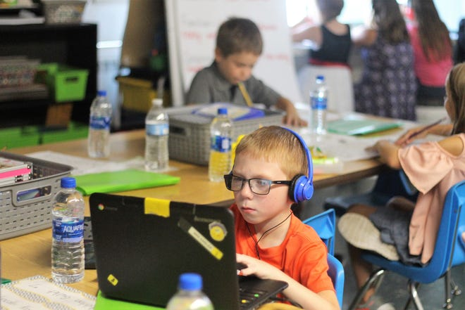 Second grader Ashton Gullet listens to a lesson inside a Ridgedale Elementary classroom.
