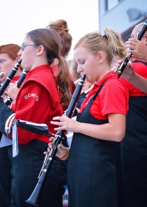 Elgin's marching band performs during last week's season opener at home.