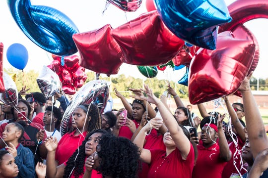 August 27, 2018 - Classmates, teammates, friends and family release balloons in honor of Dennis Mitchell at the Byhalia High School football field. Mitchell, a sophomore football player, collapsed on the field and died Friday night during a game.