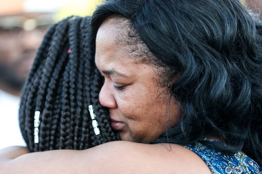 August 27 2018 - Tracy Mitchell receives a hug after classmates, teammates, friends and family of her son, Dennis Mitchell gathered to release balloons his honor at the Byhalia High School football field. Mitchell,Êa sophomore football player, collapsed on the field and died Friday night during a game.Dennis Mitchell,Êa sophomore football player, collapsed on the field and died Friday night during a game.