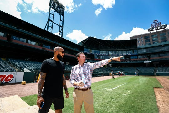 Colorado Rapids goalkeeper Tim Howard (left) and USL Memphis President Craig Unger (right) look over the early stages of transforming AutoZone Park baseball field into a soccer pitch for Saturday's ÒSoccer ShowdownÓ exhibition match.
