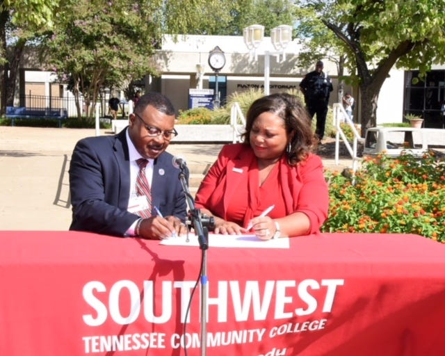 Roland Rayner, president of the Tennessee College of Applied Technology at Memphis, and Dr. Tracy D. Hall, President of Southwest Tennessee Community College, sign an articulation agreement that enables TCAT-Memphis students to matriculate to Southwest where they can earn an Associate of Applied Science degree in Automotive Technology faster and possibly tuition-free with Tennessee Reconnect scholarships. The colleges have agreements in the pipeline that will enable TCAT-Memphis students to transfer credit to Southwest to earn advanced credentials in computer science and nursing.