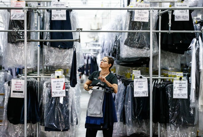 Suit-Up Inc. employee Lixuhalba Guzman readies garments for shipment from the warehouse in southeast Memphis.