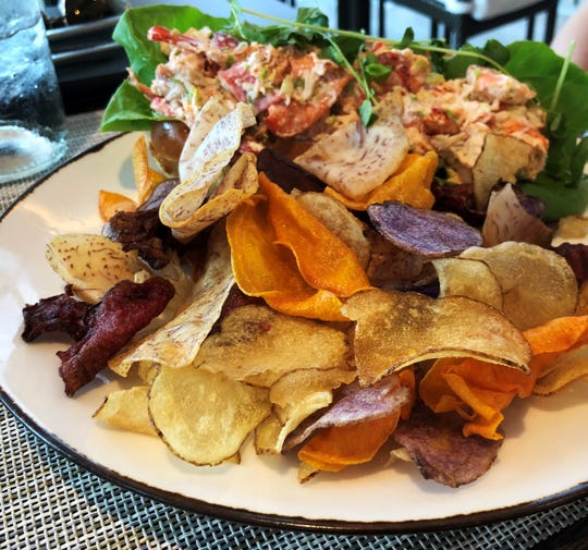 Lobster salad on a buttered bun, also with vegetable chips at The Deck.