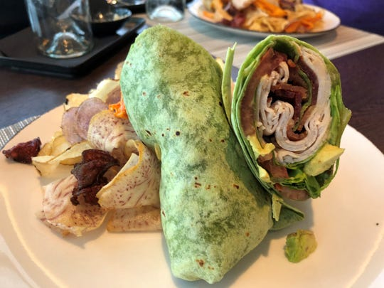 A wrap filled with turkey, bacon, avocado and greens at The Deck.