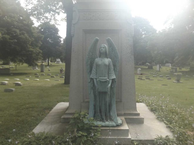 Bronze statue stolen from Forest Home Cemetery