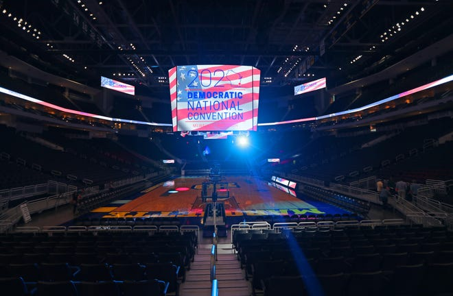 The Fiserv Forum scoreboard is lit with the 2020 DNC convention logo. The Milwaukee 2020 Convention Bid Committee held a press conference Tuesday, August 28, 2018, at the Fiserv Forum Atrium to preview the Democratic National Committee's site visit to the city as they consider where the 2020 Democratic National Convention should be held.
