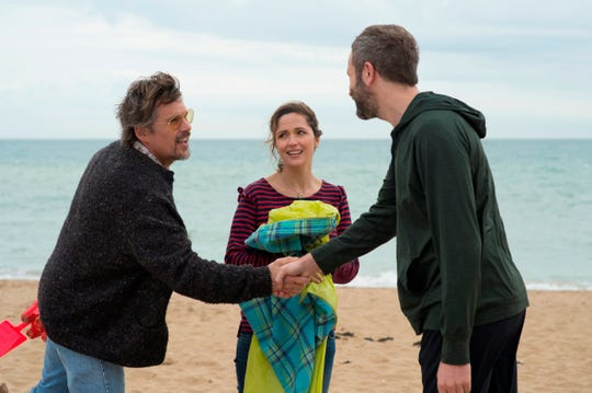 """Ethan Hawke (left) plays a nearly forgotten rocker who ends up connecting with a woman (Rose Byrne) whose boyfriend (Chris O'Dowd) is obsessed with him in """"Juliet, Naked."""""""