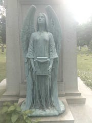 Six-foot tall bronze statue stolen from Forest Home Cemetery